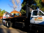 The siding arrives, bright and early