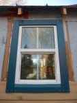 Cedar board, fitting nicely around the window :)
