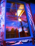 Sunset reflection in a tiny house window