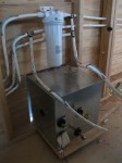 RV 500 water heater, filter above and lots of pipes
