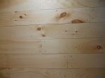Pine floor with one coat of tung oil. I know the nails are all over the place :)