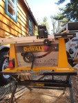 The table saw, the off side of my house and a horse trailer