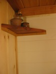 Little redwood corner shelf. That flask has rubbing alcohol in it because it looked cooler than the normal one. Gave my mum a fright :)