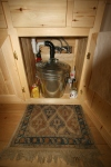 Sink plumbing and trash in the cabinet