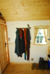 Coat rack and muddy boots