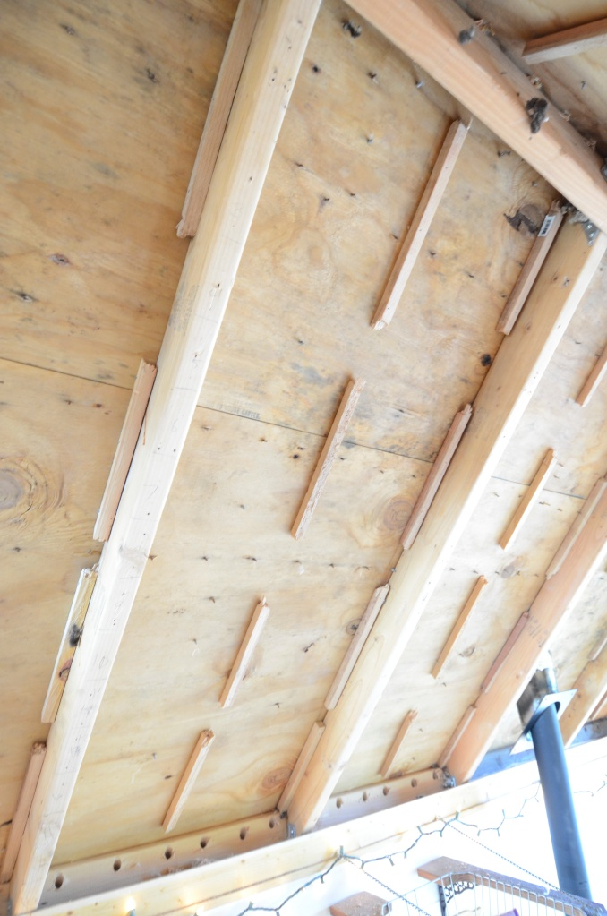 Wood strips up, ready for roofing felt to create a continuous air gap between the vent holes at the ridge and soffit